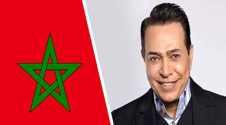 """حكيم.. مؤدي الأغنية الرسمية لـ """"الكان"""" يعتذر للمغاربة"""