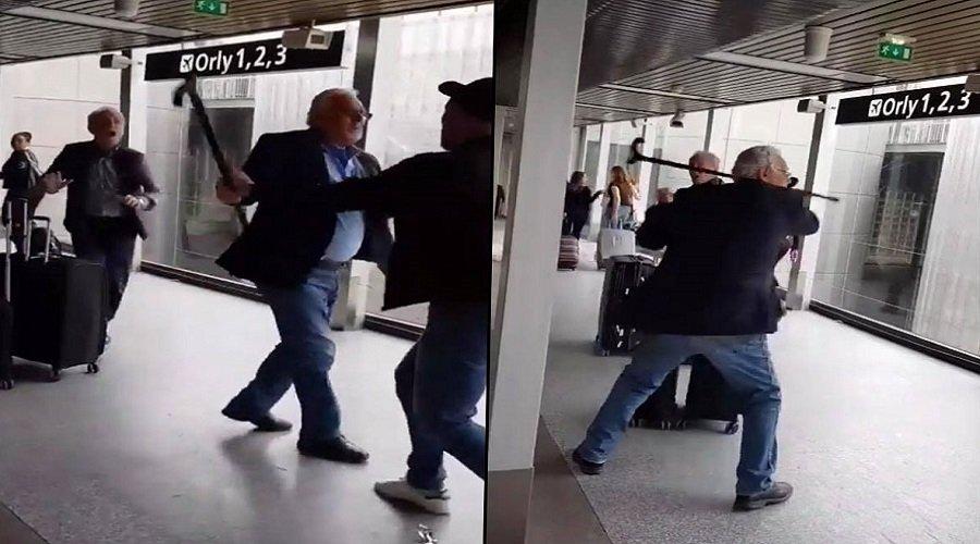 """بالفيديو.. وزير الدفاع الجزائري السابق يهاجم شابا وصفه بـ""""القاتل"""" في باريس"""