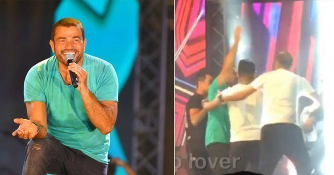 """بسبب """"معجب """".. عمرو دياب يصفع حارسه الشخصي أمام الجمهور"""
