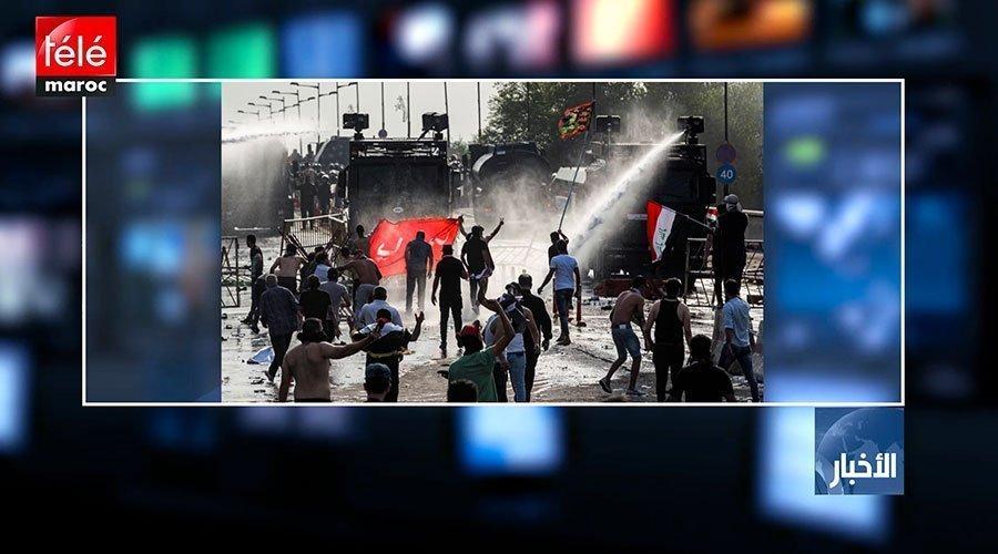 قتيل و32 جريحا في اشتباكات بين متظاهرين وقوات الأمن وسط بغداد