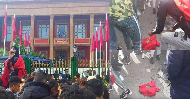اعتقال قاصرين متهمين بإحراق العلم الوطني